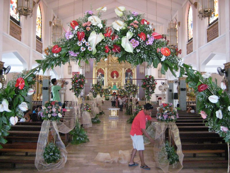 The flower decorations in the church are almost finished